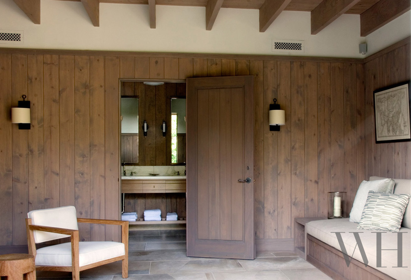 Knotty wood paneled den in Provence style guest house by architect William Hefner. #rusticdecor #paneling #Provence #Provencal #interiordesign