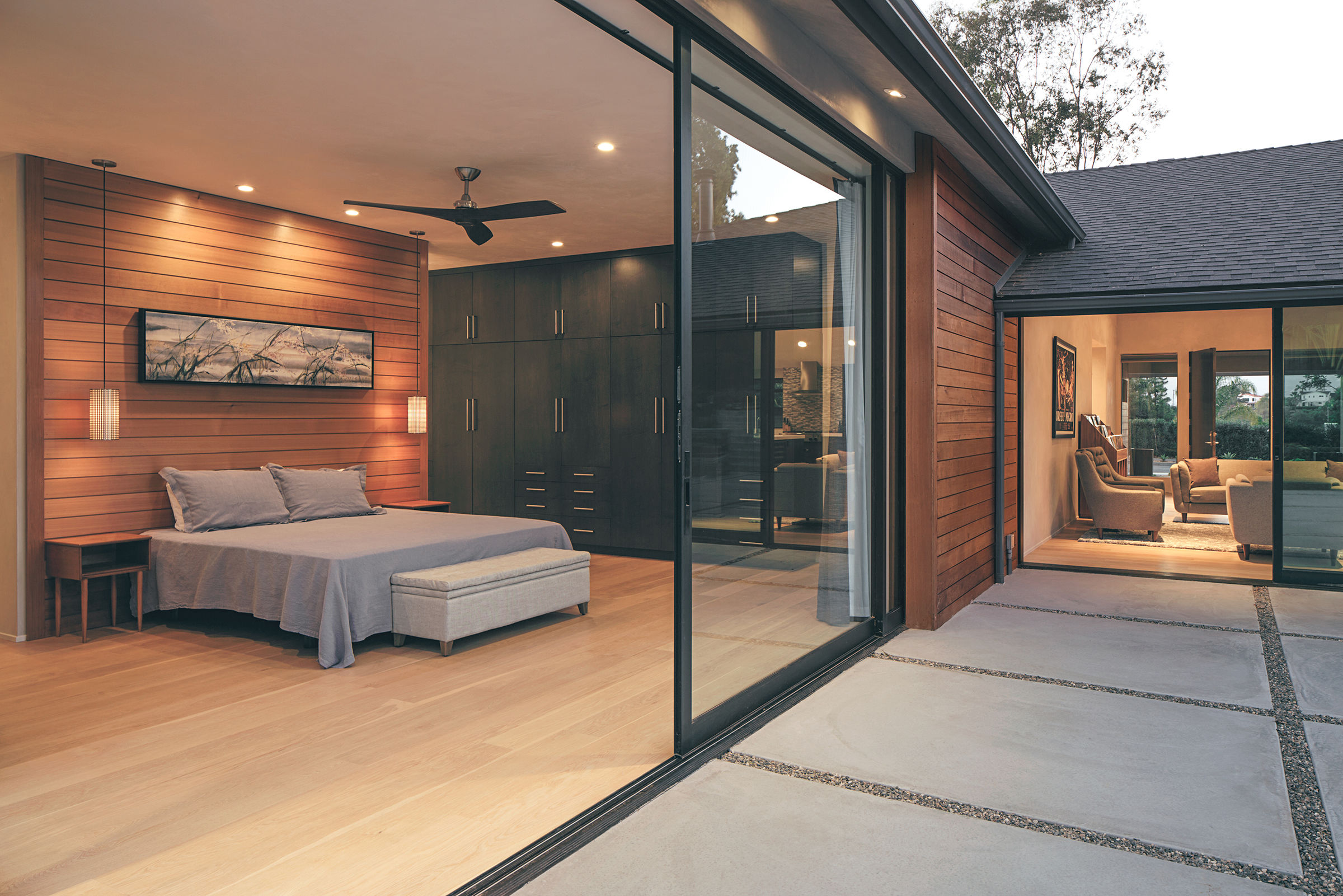 One of two massive pocketing Series 600 Multi-Slide Door in the master suite increase the residents' living space.