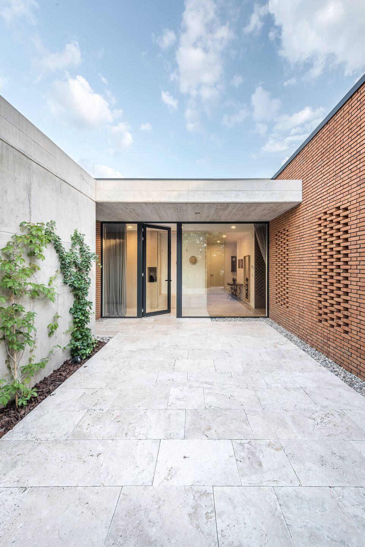 House With A Stone Patio Beef Architekti Archello