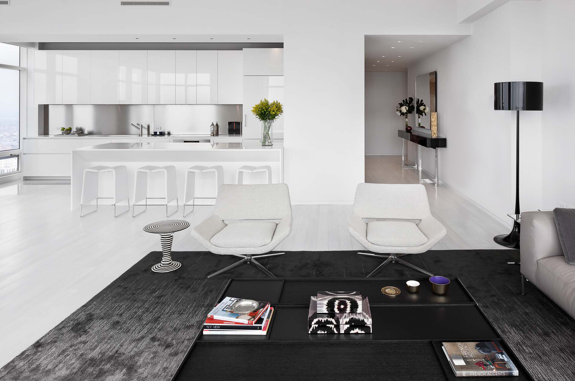 KITCHEN AND LIVING ROOM: Glossy Polyester Lacquer with stainless stell blacksplash kitchen by Boffi; Corian kitchen island custom designed by Giusi Mastro;  B&B Italia sofa; Kasthall carpet; lamp by Flos; coffee table by B&B Italia; flooring by LV Wood