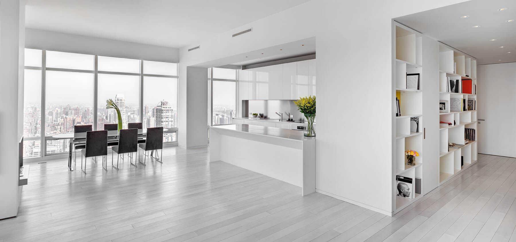 KITCHEN AND LIVING AREA with floor-to-ceiling bookshelf custom designed by Giusi Mastro